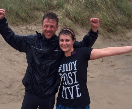 Photo of personal trainer and client after a run at the beach