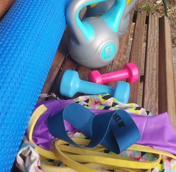 Photo of a selection of fitness equipment on a park bench
