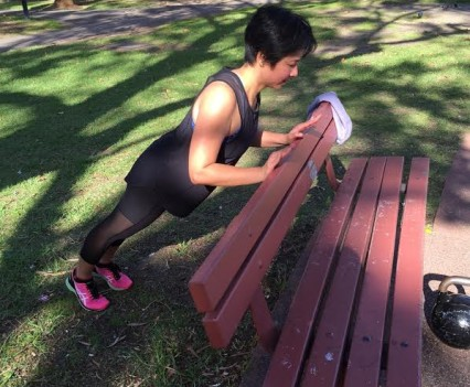 Woman doing exercise in the park